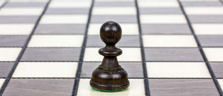 strangers: a pawn on a chessboard