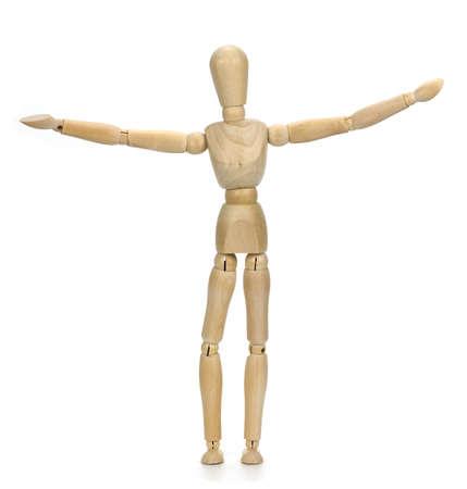niño parado: maniquí de madera sobre un fondo blanco Foto de archivo