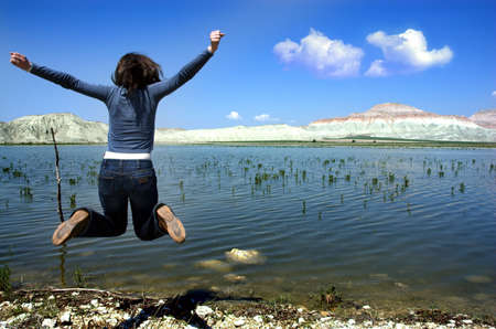 full strenght: Happy Girl Jumping Stock Photo