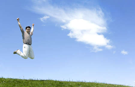 Businessman Jumping Up into Sky photo