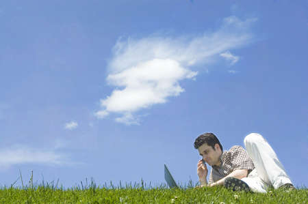 Businessman Working on the Grass photo