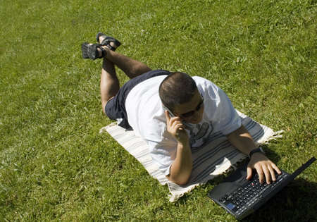 working with laptop on grass photo