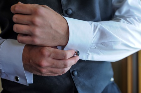 cuff: man wear a white shirt and cuff links