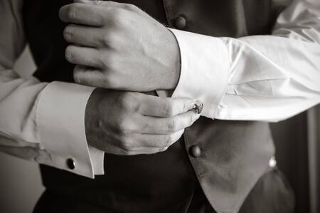 cuff: man wear a white shirt and cuff links