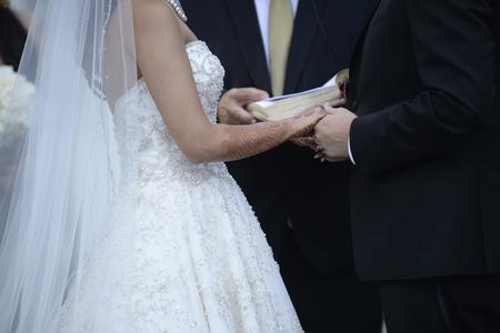 ortodox: Happy stylish newlyweds in the ortodox church at wedding Stock Photo