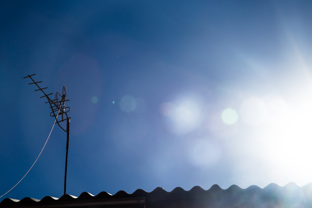 sun roof: The antenna on the roof, blue sky and shining sun Stock Photo