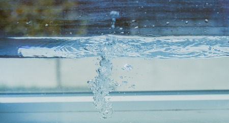 Flowing water with bubbles in the aquarium