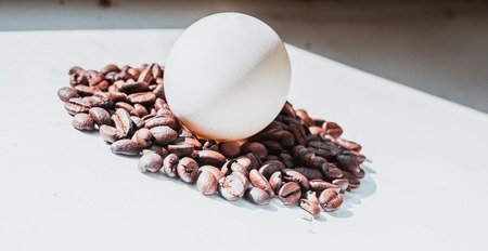 Coffee beans and Easter egg dyed with coffee on a background of burlap