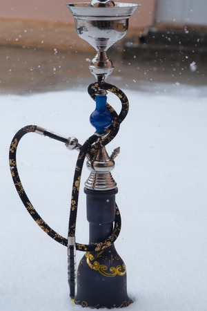 Big hookah for tobacco smoking made of metal, glass and ceramics.