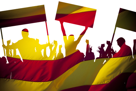 Silhouettes of protesting people against the the flag of Barcelona on white background. Isolated. People are on strike. Independence of the catalonia. Departure from Spain. A crisis. Barcelona, Spain. Stock Photo
