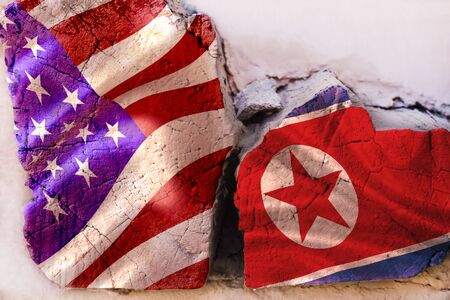 Symbol of crisis relations between countries. Broken square log wood with flags of USA and North Korean Republic. Nuclear war. The conflict between Russia and North Korea. Political concept.