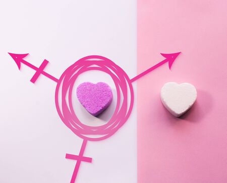 Third Gender. Transgender Symbol with heart shaped sugar candies on divided background Stock Photo