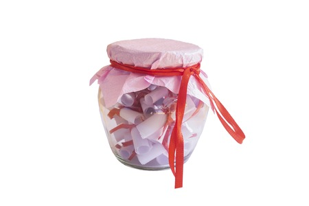 Couples date jar or glass jar filled with paper notes isolated on white background