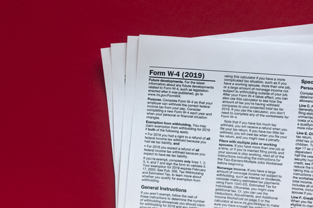 Form W-4 2019. U.S. Internal Revenue Service or IRS tax form on red Stock Photo