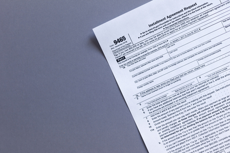 9465 irs tax form. US TAX FORMS with copy space Stock Photo
