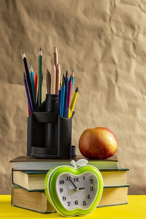 Back to school concept. Stack of books with school supplies.