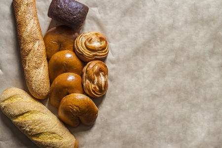 Food concept. Different type breads. Top view. Free space for text. Copy space Stock fotó