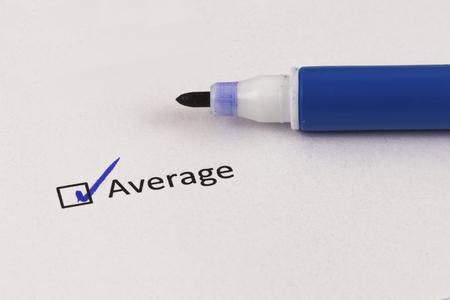 Fragebogen. Kästchen mit Aufschrift Durchschnitt und blauer Markierung.