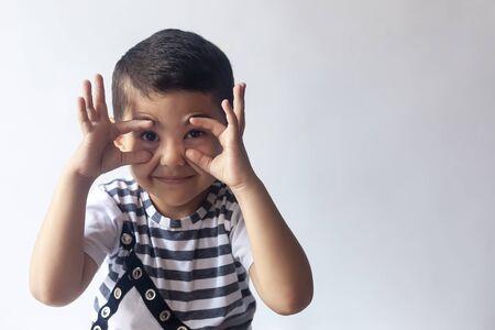 Six years boy portrait. Innocent smiling little boy on grey background. Little kid having fun. People, childhood lifestyle concept.