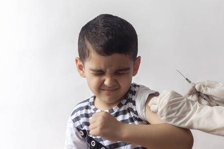 A doctor vaccinating young patient. Little boy scared of injection. Child's Immunization, Children's Vaccination, Health conception