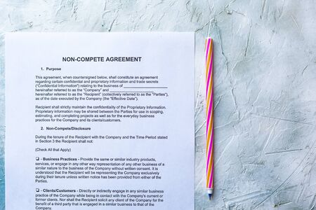 Filling Non-Compete Agreement Form. View from above Stock Photo