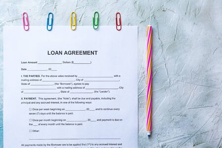 Filling Blank Loan Agreement Form. Top view Archivio Fotografico
