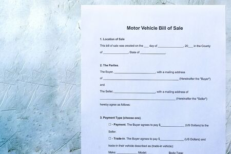 Empty form of Motor vehicle bill of sale. View from above. Stock Photo