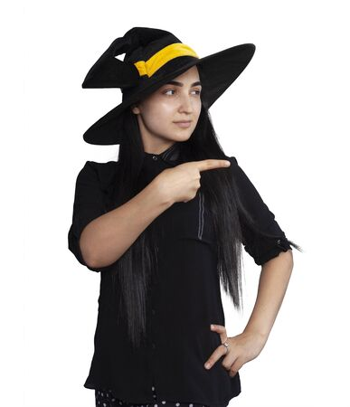 Portrait of a young woman in witch costume isolated on white background. Halloween theme on white. Different facial expressions of young beautiful middle-eastern woman. Halloween witch having fun 写真素材