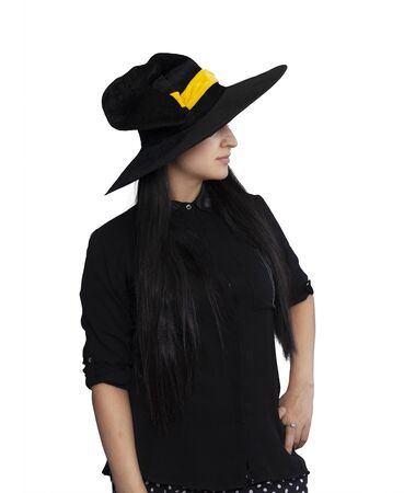 Portrait of a young woman in witch costume isolated on white background. Halloween theme on white. Different facial expressions of young beautiful middle-eastern woman. Halloween witch having fun