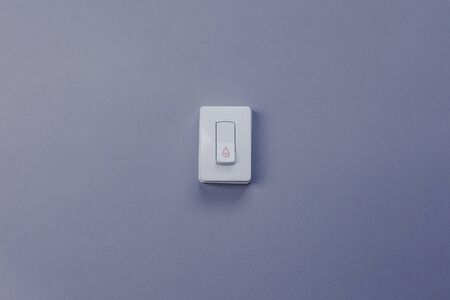 Ring bell. Doorbell button on grey wall