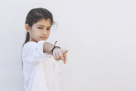He Offended Me. School girl saying it's him pointing with her finger. Showing hand gesture this is him, he hurt me. Negative emotions. The upset girl points to the offender. Copy space
