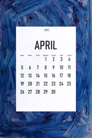 April 2020 simple calendar on painted background with trendy Classic Blue color Reklamní fotografie