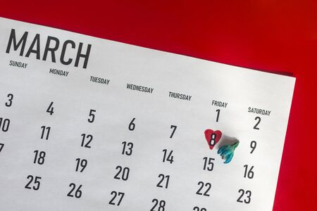March 2020 monthly calendar with 8th march marked or highlighted. International women day. March calendar with a bunch of spring flowers on bright colorful background. Top view. View from above