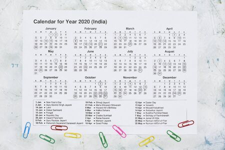 Yearly paper calendar for India. 2020 yearly calendar with Indian national holidays. View from above Stock Photo