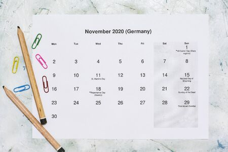 Monatskalender November 2020. Translation: Monthly November 2020 calendar. Paper November month calendar in Dutch. Top view