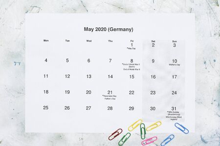 Monatskalender Mai 2020. Translation: Monthly May 2020 calendar. Paper May month calendar in Dutch. Top view