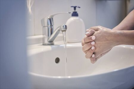 Woman washing hands with soap. An unrecognizable female showing how to wash hands properly. 版權商用圖片