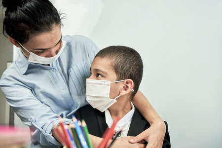 Back to school. Mother preparing son to school. Schoolboy getting ready to go to school. Mom hugs son. Emotional expression Reklamní fotografie