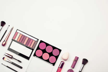 Luxury make-up kit. Background image for beauty salon banner design. Makeup cosmetic products on white background. Top view with copy space
