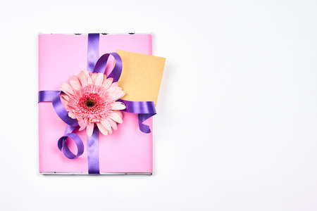 Cute spring gift boxes with daisy flowers. Spring floral background with present boxes