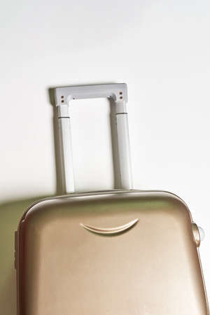 Cropped shot of a suitcase over white wall
