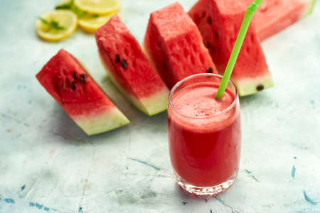 Super delicious and sweet watermelon juice on the glass. Fresh summer fruits background. Sweet watermelon slices. Watermelon fruit