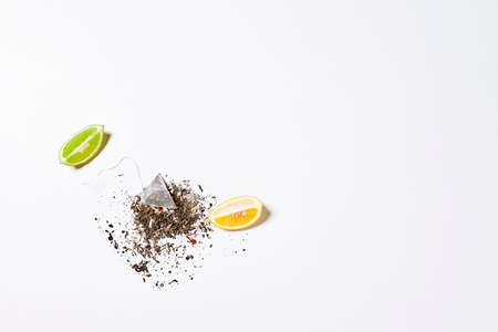 Lime and lemon based tea on white background. Fruit tea 免版税图像