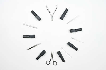 Nail artist tools set in a circle. Professional manicure tools and nail gels on white background with copy space