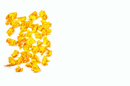 New idea concept. A group of yellow crumpled paper balls on white background with copy space