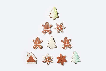 Xmas sweets on white background making form of Christmas tree