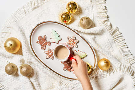 Merry Christmas background with Xmas decors and cookies. Tasty Christmas cookies and X-mas tree baubles. Celebrating Christmas and New year
