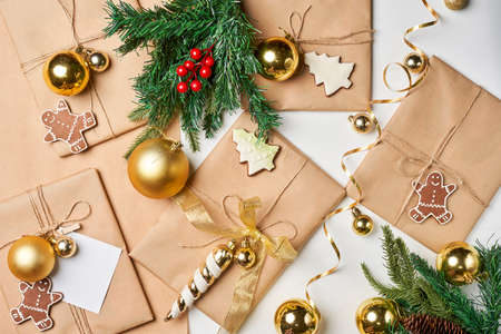 Preparing Christmas gifts with craft paper at home. Homemade Christmas presents. Bright Christmas background with colorful Xmas decorations
