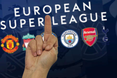 Tashkent, Uzbekistan - April 27, 2021: Hand showing middle finger to The super league logo. Soccer fan showing fuck hand gesture to The super league logo. Annual club football competition Editorial