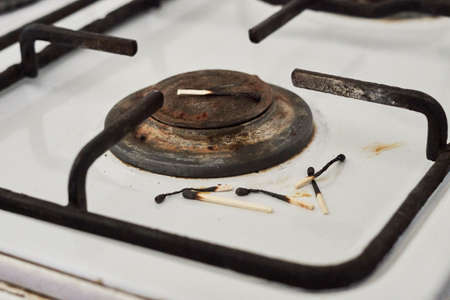 Gas stove and burned matches. Lack of natural gas, no gas, gas shortage problems or tariff bills prices growth concepts